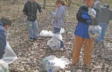 Volunteers brave chilly weather to remove trash around reservoir