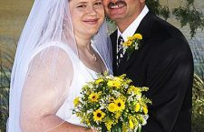 Hett and Schmidt married Oct. 18