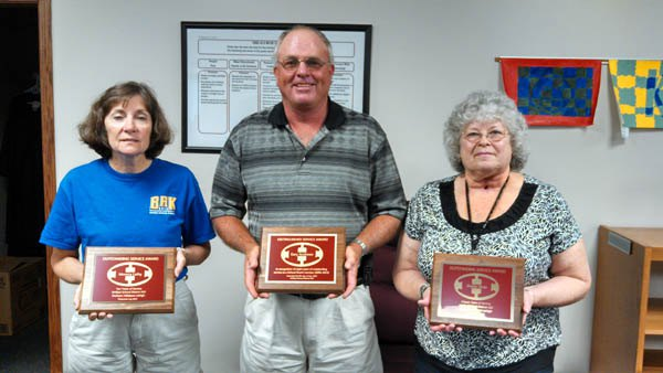 USD 410 recognized three employees and a board member who are leaving the district either through retirement or the end of their service term: (from left) Monica Leihy, a teacher for 10 years; Gary Andrews, a board member from 2005 to 2013; and Sheila Nuss, a bus driver for 15 years. Not pictured is Michele Goldsby, a teacher for 16 years.