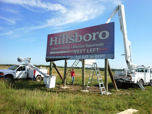 City workers give billboard along U.S. 50 a facelift