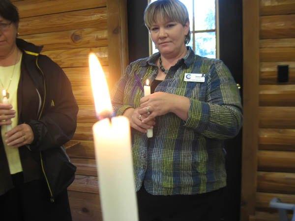 Vigil draws attention to local domestic violence