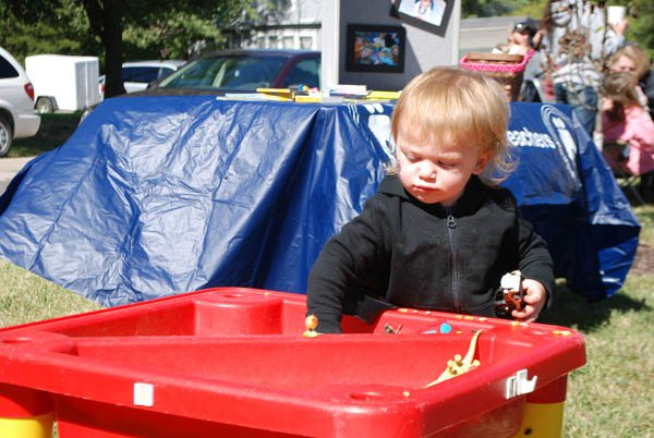 Rhett Noeth of Ramona plays with different types of grain at the Lincolnville Octoberfest last weekend.