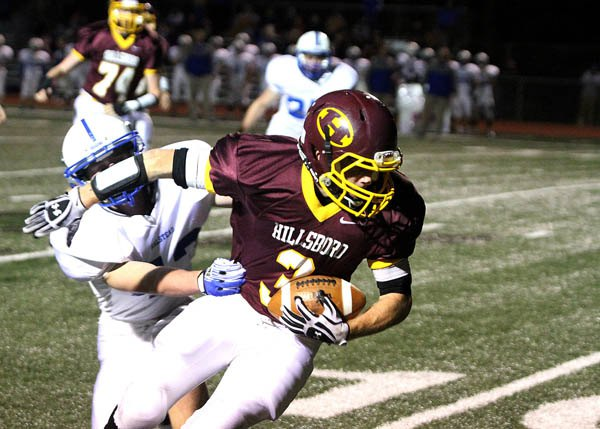 Hillsboro's Preston Nelson spins out of the grasp of a Halstead defender near the 10-yard line and completes the 13-yard touchdown pass reception during the first quarter of Thursday's game.