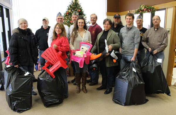 Toy Run organizers distribute funds, gifts for local families