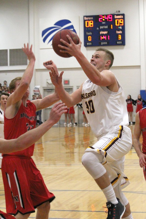 Christian Ratzlaff drives for the hole against Moundridge, but on this play he was called for charge.