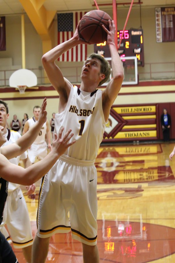 Avery Franz scores two of his career-high 12 points iagainst Peabody-Burns Tuesday.