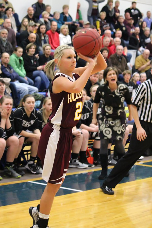 Maddie Duerksen shoots for three in front of the Sterling bench during the first quarter.