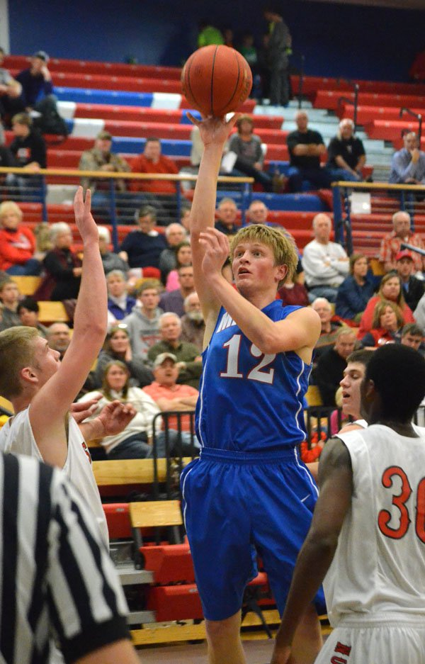 Zach Robson makes the second of two consecutive baskets during the second quarter Thursday. Robson led Marion with 12 points.