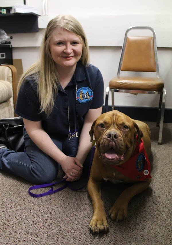 Dog and owner overcome obstacles to help others