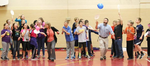 Teachers Collette Haslett and Rod Just take part in an all-male vs. all-female version of the balloon relay ? cheered on by students of the appropriate gender. Haslett emerged as the victor.