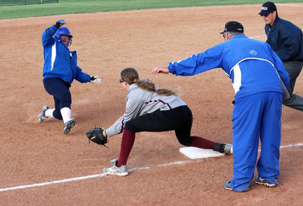 Hillsboro third baseman Shannon Heiser prepares to lay the tag on Lyons? Morgan Michaelis, who was trying to stretch a double into a triple during Game 2 of last Tuesday?s doubleheader. Strong relay throws from outfielder Kennedy Lucero and second baseman Bradli Nowak resulted in the out, which provided an emotional lift for the Trojans, who went to win the game 9-3 and finish the regular season 18-2.
