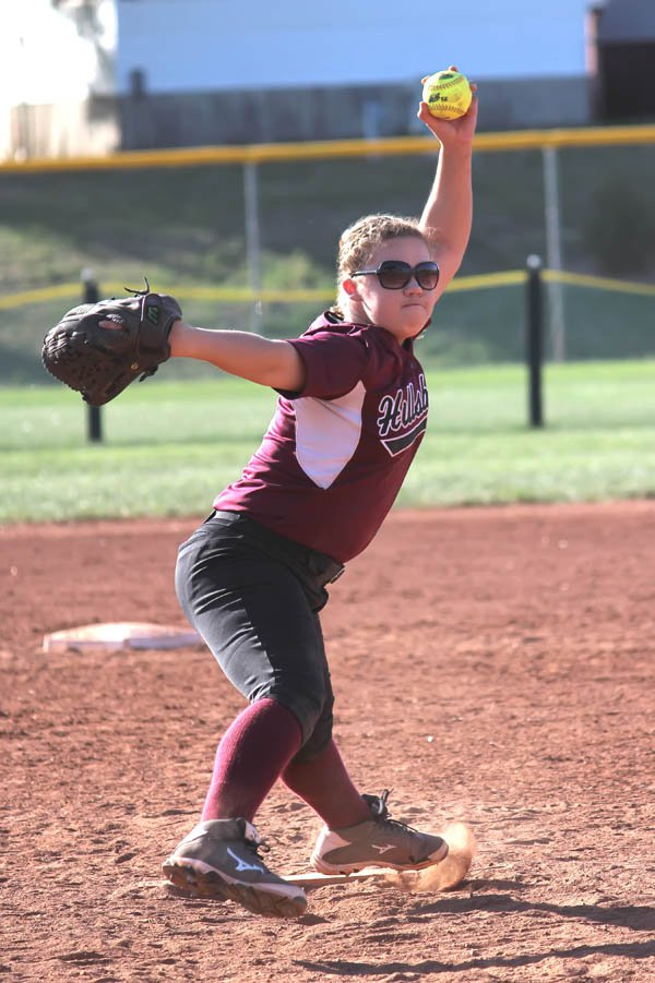 Julie Sinclair fires a pitch toward home during Hillsboro?s 5-2 victory over Pratt Friday. The junior left-hander struck out a career-high nine batters in a seven-inning complete game.