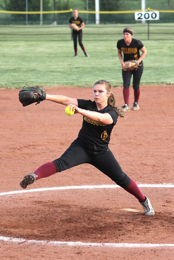 Julie Sinclair prepares to fire a pitch to homeplate during the regional championship game against Inman. Sinclair limited the Teutons to one hit while striking out a school record 17 batters in Hillsboro?s 7-0 victory.