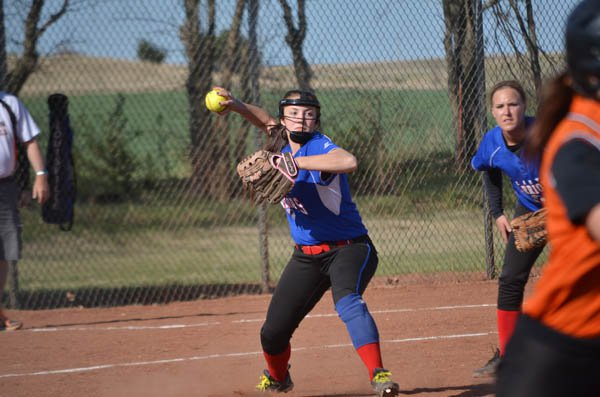 Reann Hamm throws to first during Game 1 against Inman Friday. Marion lost a close game, 9-8, before winning the nightcap, 10-6.
