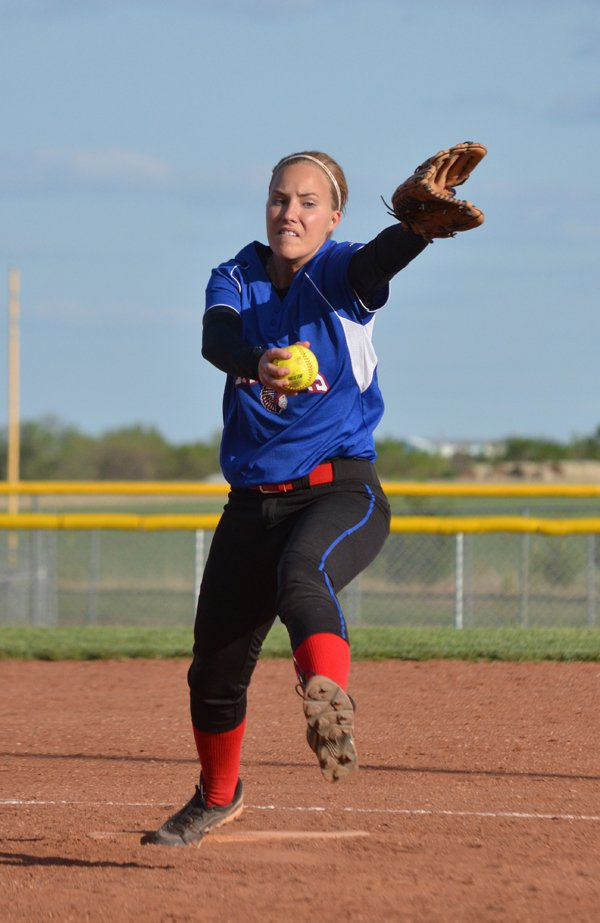 Megan Richmond fires a pitch during Game 2 against Little River Tuesday. Over three innings, she gave up two hits and one run (earned). She did not walk anyone and struck out six batters in Marion?s 15-5 victory.