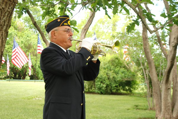 Larry Cushenberry plays taps on the cornet during Monday?s Memorial Day Services in Hillsboro. A similar scene was played out in numerous communities in the county as citizens gathered to recognize the sacrifices of the men and women who have served their country in the military.