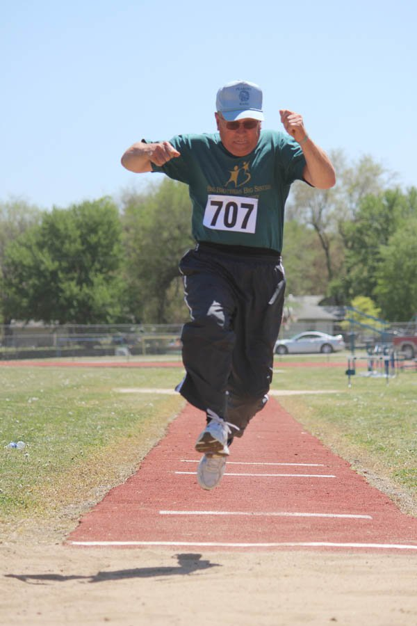N.M. Patton, 67, takes a leap in the long jump. He competed in the 60-plus age category.
