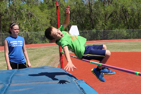 Fourth-grader Weston McFall clears the high jump bar at 3 feet, 4 inches. He went on to win the kids division by clearing 3-6.