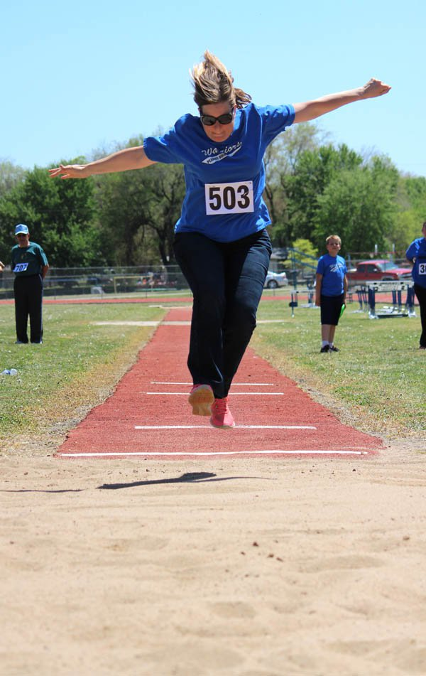 Tina Spencer, who works as county clerk when she?s not training, soars through the air for a leap of 5 feet 7 inches in the long jump. Her best leap was 5-81?2.