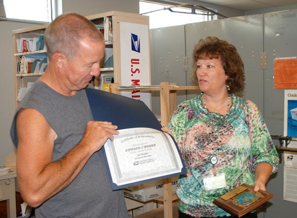 Weber feted by USPS for safe driving