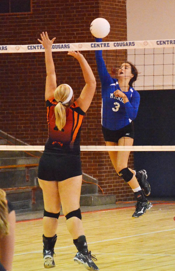 Julia Hall attacks the net during Set 1 of the championship against Rural Vista Saturday at the Centre tournament. Marion claimed the title in two sets.
