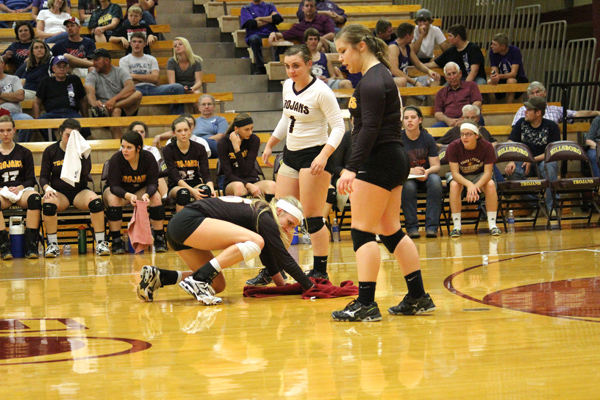 Bradli Nowak (1) and Julie Sinclair inspect for additional perspiration on the floor while Alex Ratzlaff works to wipe them off the playing surface.  The championship game was halted several times to take care of the floor in an effort to eliminate falls and injuries. Don Ratzlaff / Free Press