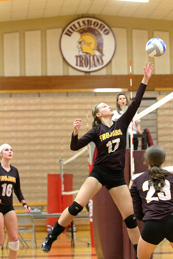 Senior Emily Jost taps the ball over the net during a long volley during the second set of the championship game against Southeast of Saline. Phyllis Richert photo