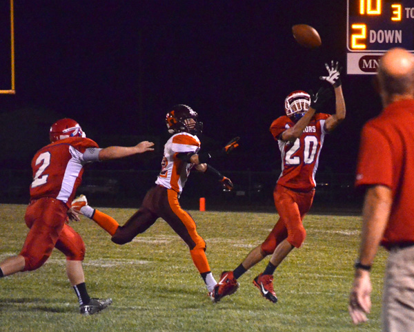 Brad Stone intercepts a Railer pass during the first quarter against Herington Friday. It was the first of three interceptions thrown by the Railers in Marion?s 56-8 win.