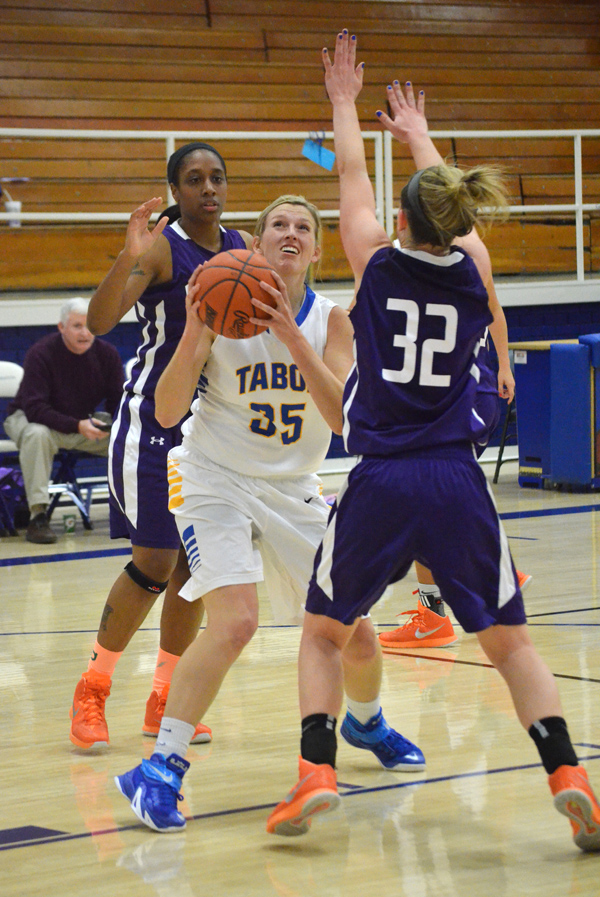 Taylor Janzen eyes the basket during the first half of Tabor's home game against Missouri Valley Tuesday. Janzen contributed nine points in Tabor's 70-66 victory. The Bluejays defeated the Vikings a second time Saturday, 77-64. Janae Rempel / Free Press