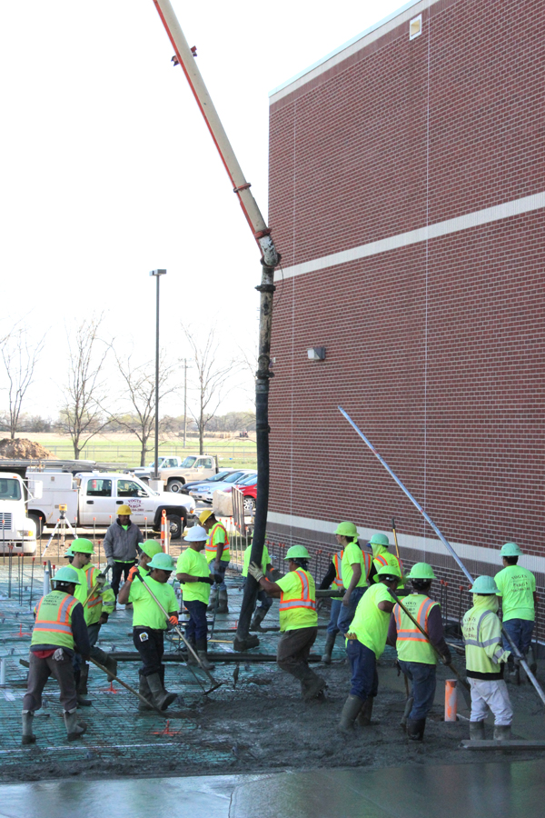 The construction project at Goessel schools made major headways during 2014. Here a crew pours a concrete floor at the high school in late April. Free Press file photo