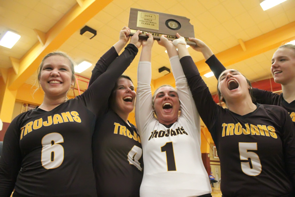 Hillsboro seniors celebrate the team?s sub-state championship plaque that qualified the Trojans for their seventh consecutive state appearance in fall. The team finished as the Class 3A runner-up after winning two 3A and one 2A state title the previous three years. Free Press file photo