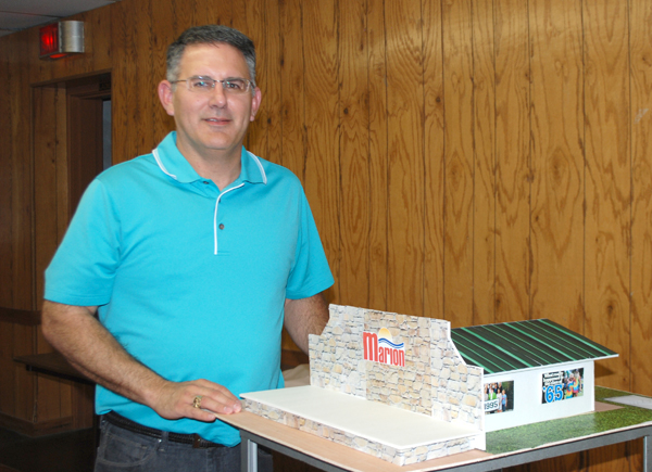 Todd Heitschmidt, president of Marion Advancement Campaign, shows a model that closely represents what the stage, entertainment pavilion and restrooms would look like when completed. The cost for this first phase is $105,000, and thus far $90,000 has been either pledged or donated. Patty Decker / Free Press
