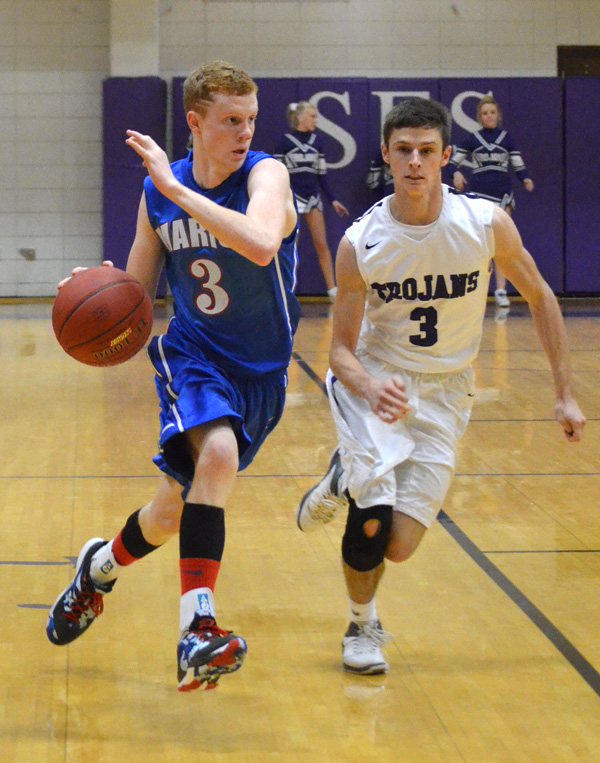 Mason Pedersen drives downcourt during the second half at Southeast of Saline Friday.