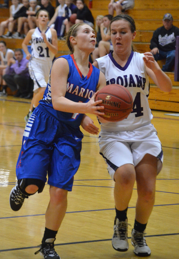 Kirsten Hansen draws a foul during the third quarter at Southeast of Saline Friday. She made one of two shots from the charity stripe.