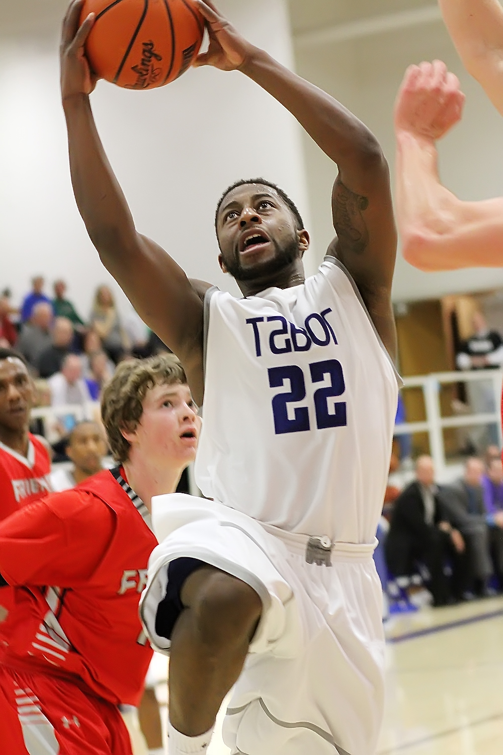 Malik Brooks scores two points for Tabor during the first half against Friends Saturday. Brooks scored a game-high 22 points in Tabor's 73-64 victory over the Falcons. Phyllis Richert Photo