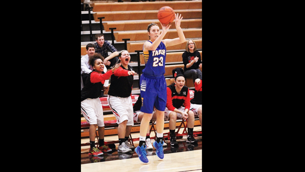 Mikaelyn Dick drains a three-pointer in the final seconds of the first half to give Tabor a 37-34 lead over McPherson at halftime Saturday. Tabor went on to win, 67-56. Phyllis Richert Photo