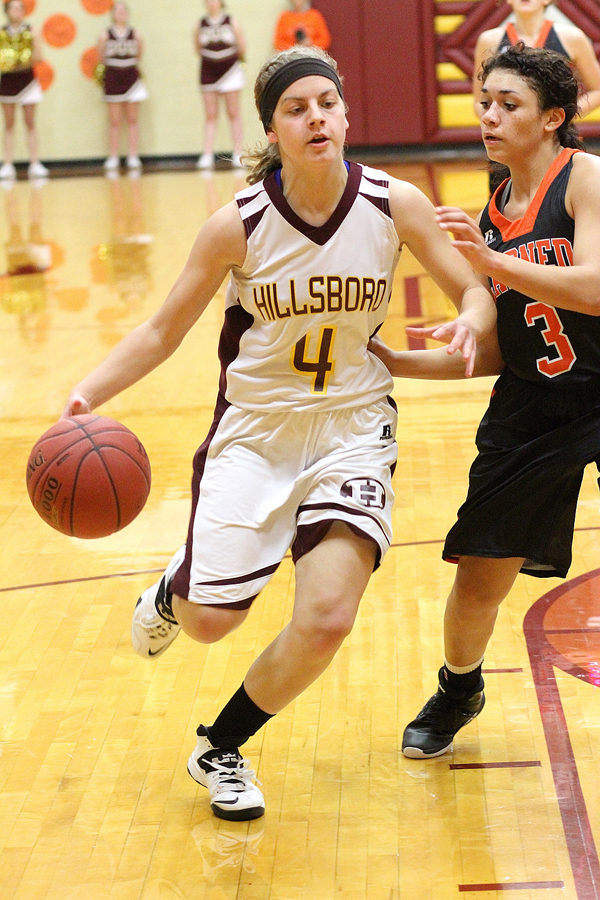 Marah Franz drives toward the basket during the second quarter against Larned Friday. Hillsboro won the game, 34-27, snapping a five-game losing streak. Phyllis Richert Photo