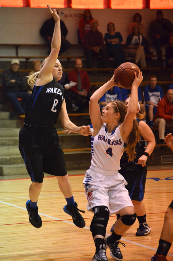 Marion girls win, boys lose first games at Centre