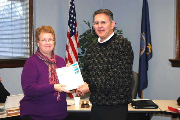 Janet Marler, Marion City Library director, was recognized at the Jan. 5 council meeting for 25 years of service. Mayor Todd Heitschmidt presented Marler with a distinguished service certificate for her dedication and commitment. In his presentation, Heitschmidt proclaimed Jan. 9 as ?Janet Marler Day.? Patty Decker / Free Press