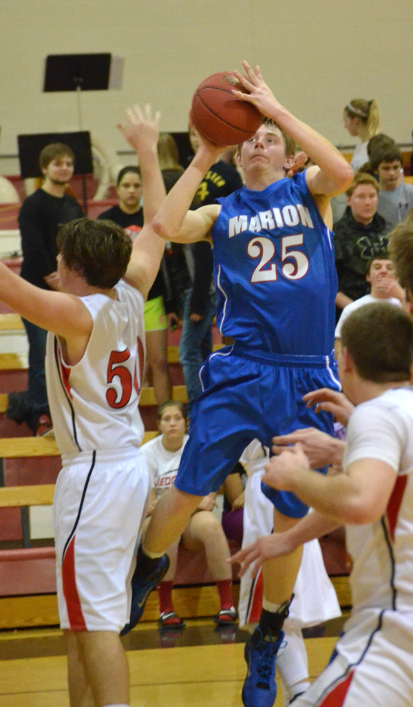 Nicholas Stuchlik scores to tie the game at 22 during the third quarter at Sedgwick Tuesday. Stuchlik led the Warriors with 12 points in Marion?s 43-40 loss.