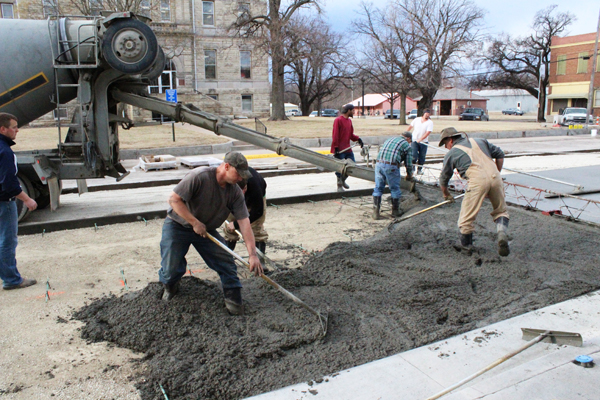 A crew from Hett Construction pours concrete to replace a block of Third Street near the Marion County Courthouse in early 2014. This project was one of several projects the city took on during the year to improve local infrastructure. Free Press file photo