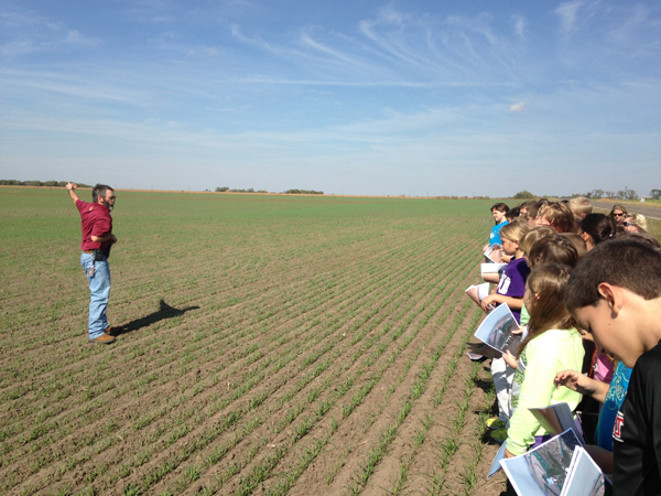 Rod Just, fourth-grade teacher at Hillsboro Elementary School, explains soil conservation practices applied to this field during his field tour last spring. Courtesy photo