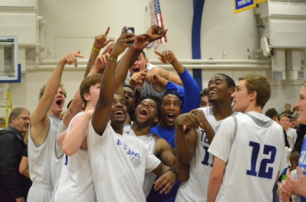 Members of the Tabor College men?s basketball team celebrate their newly won Kansas Collegiate Athletic Conference regular-season championship in social-media style by taking a team ?selfie? after an 87-73 win over Ottawa University Saturday night in Hillsboro. The Tabor women?s team secured their own KCAC championship earlier in the evening by beating Ottawa, 60-57. It was the first time since 2004 that both the men and women won their respective team titles in the same season. For details about the double conquest see sports.  Janae Rempel / Free Press