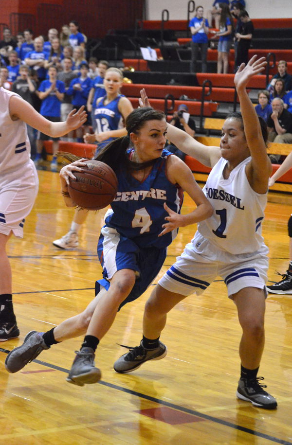Centre?s Shelby Makovec drives into the lane guarded by Goessel?s Aleena Cook. Makovec led all scorers with 26 points in Centre?s 37-21 sub-state championship win. Janae Rempel / Free Press