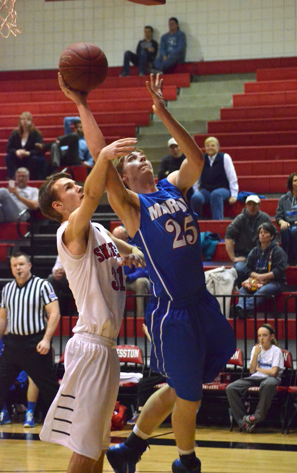Nicholas Stuchlik shoots for two during the second half at Hesston Tuesday.