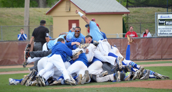 The 2014 Tabor College baseball team celebrates its Opening Round Tournament title in traditional dog-pile style. The win qualified the Bluejays for the NAIA World Series for the first time in school history. Free Press file photo