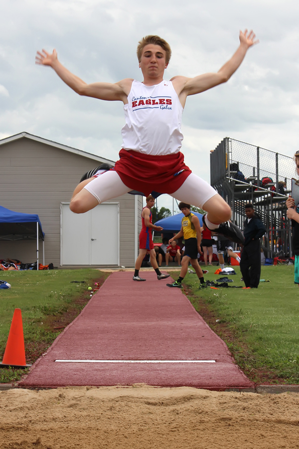 Trey Moddelmog leaps to an 11th-place finish in the long jump (17-83?4) at the Heart of America league track meet at Marion Friday. Moddelmog paced the Canton-Galva boys by winning the high jump (6-0).  Don Ratzlaff / Free Press