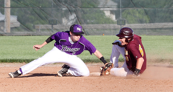 After leading off the top of the 5th inning with a walk, David Dick senior slides in to second base for a stolen base during the regional first-round game with Southeast of Saline May 18. Hillsboro led by as much as 5-2, but ended up losing, 6-5. Phyllis Richert photo