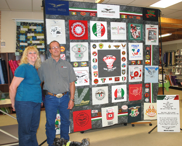 Marie Kessler and Bob Kasitz pose by the T-shirt quilt Kessler created for Kasitz to memorialize his brother David?s love for motorcycle adventures. Patty Decker / Free Press