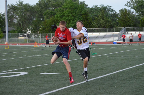 Marion?s Zachary Stuchlik catches a pass while defended by Hillsboro white?s Ben Koop. Free Press Photo by Janae Rempel